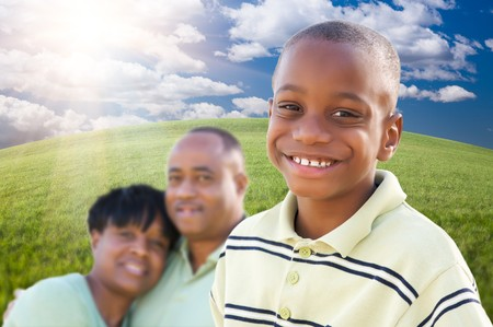 three generations of women: Handsome African American Boy with Proud Parents Standing Over Clouds, Sky and Arched Horizon of Grass Field.