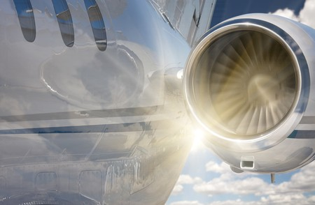 fuselage: Private Jet and Engine Abstract With Sunburst and Clouds. Stock Photo