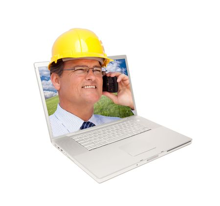 Laptop and Man with Hard Hat on Cell Phone Extruding the Screen. Stock Photo - 7057611