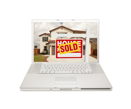 real estate sold: Sold For Sale Real Estate Sign on Computer Laptop Isolated on a white Background.