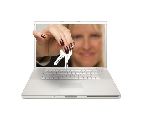 Woman Handing House Keys Through Laptop Screen Isolated on a White  Background.