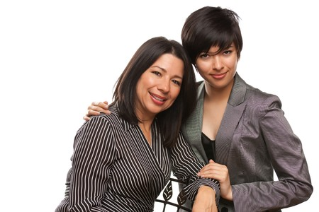 Attractive Multiethnic Mother and Daughter Portrait Isolated on a White Background. photo