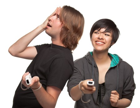 Diverse Couple with Video Game Controllers Having Fun Isolated on a White Background. photo