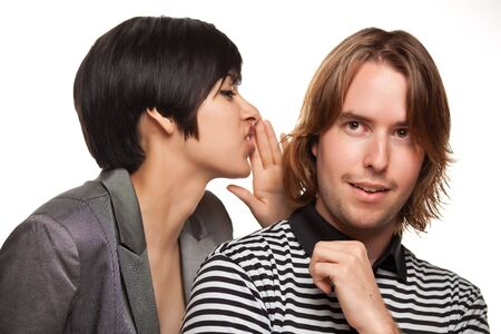 Attractive Diverse Couple Whispering Secrets Isolated on a White Background. photo