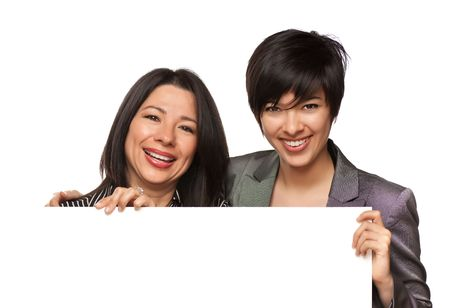 Attractive Multiethnic Mother and Daughter Holding Blank White Sign Isolated on a White Background. photo