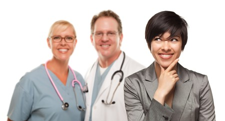 male doctor: Young Multiethnic Woman and Two Doctors Isolated on a White Background.