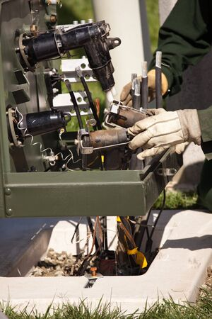 Utility Workers with Leather Gloves Installing New Electrical Equipment. photo