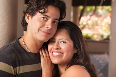 Attractive Hispanic Couple Portrait Enjoying Each Other Outdoors. Stock Photo - 7172135