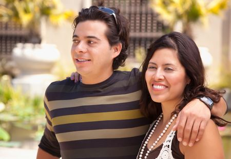 Attractive Hispanic Couple Enjoying Themselves At The Park. Stock Photo - 7172137
