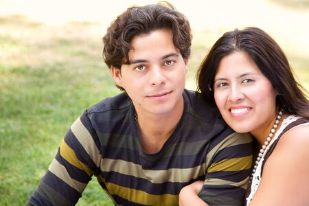 Attractive Hispanic Couple Portrait Enjoying Each Other Outdoors. Stock Photo - 7172127