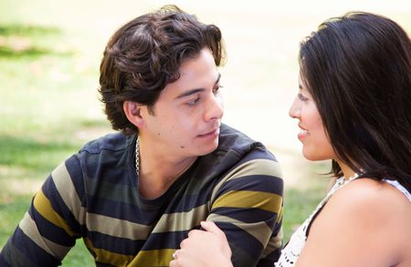Attractive Hispanic Couple Enjoying Themselves At The Park. Stock Photo - 7172139