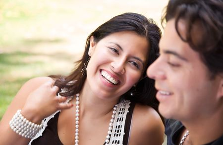 Attractive Hispanic Couple Enjoying Themselves At The Park. Stock Photo - 7172126