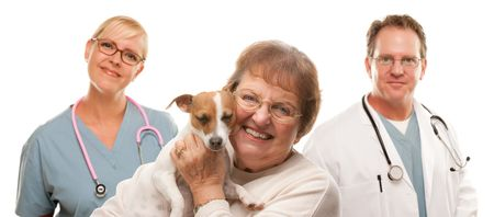 Happy Senior Woman with Dog and Veterinarian and Nurse Isolated on a White Background. photo