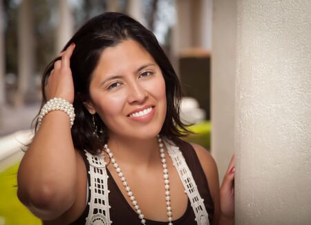 mexican woman: Attractive Smiling Hispanic Young Adult Woman Portrait Outside. Stock Photo