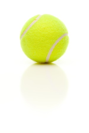 tennis ball: Single Tennis Ball with Slight Reflection Isolated on a White Background.