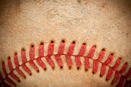 hardball: Macro Abstract Detail of Worn Leather Baseball with Vignette.