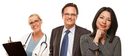 Attractive Hispanic Woman with Husband and Female Doctor Isolated on a White Background. photo