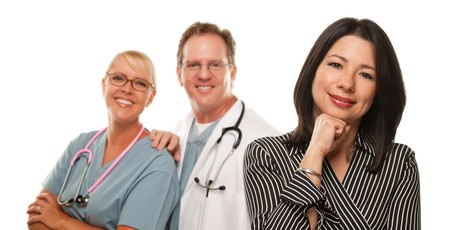 Hispanic Woman with Male Doctor and Nurse Isolated on a White Background. Stock Photo - 7275257