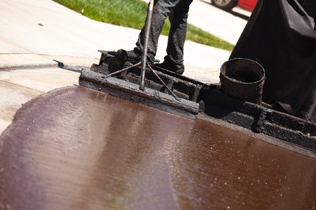 Road Worker Resurfacing Street with Hot Tar. Stock Photo - 7303645