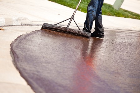 resurfacing: Road Worker Resurfacing Street with Hot Tar.