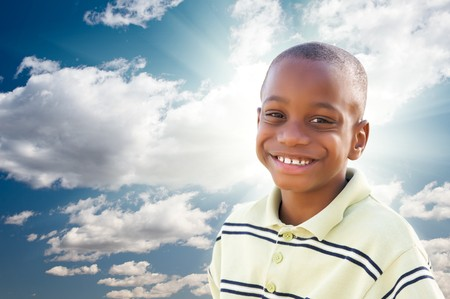 Young Happy African American Boy with Dramatic Clouds and Sky and Sun Rays. Stock Photo - 7319195