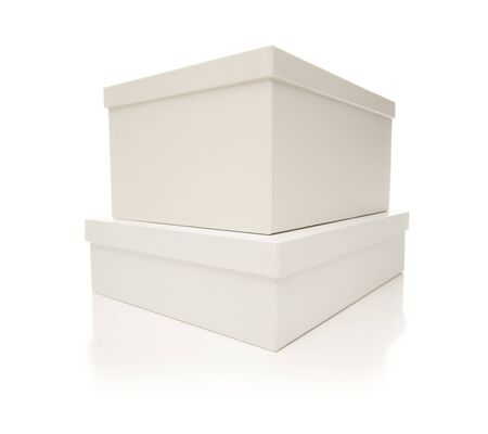 Two Stacked White Boxes with Lids Isolated on a White Background. photo