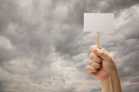 textfield: Man Holding Blank Sign Over Dramatic Storm Cloudy Sky - Ready For Your Own Message on Sign and Over Clouds.