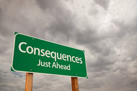 Consequences Just Ahead Green Road Sign with Dramatic Storm Clouds and Sky.