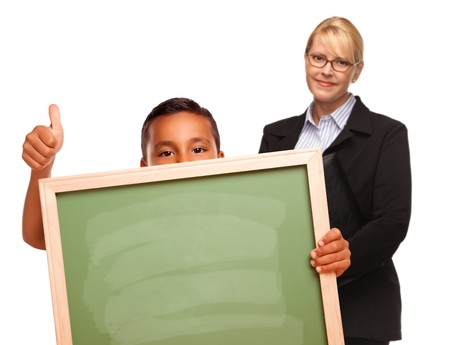 Hispanic Boy Holding Chalk Board with Thumbs Up and Female Teacher Behind Isolated on a White Background. photo