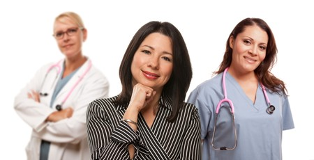 Hispanic Woman with Female Doctor and Nurse Isolated on a White Background. Stock Photo - 7375008