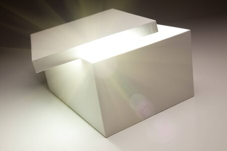 White Box with Lid Revealing Something Very Bright on a Grey Background.