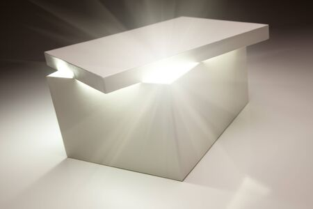 storage box: White Box with Lid Revealing Something Very Bright on a Grey Background.