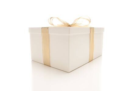 White Gift Box with Gold Ribbon and Bow Isolated on a White Background. Stock Photo - 7419955