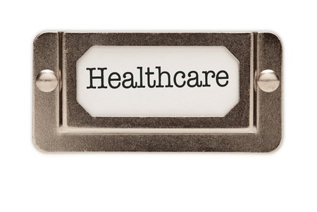 health reform: Healthcare File Drawer Label Isolated on a White Background.