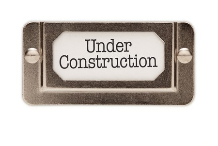 Under Construction File Drawer Label Isolated on a White Background. photo