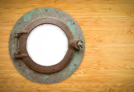 Antique Porthole on Bamboo Wall with White, Blank Window - Contains Inner Clipping Path. photo
