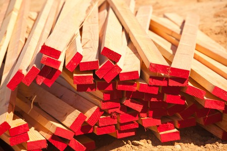 material: Abstract Stack of 2x4 Construction Wood with Red Painted Ends. Stock Photo