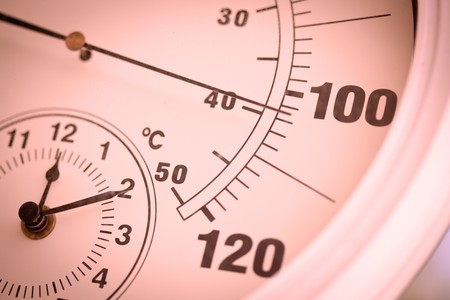 colorized: Colorized Round Outdoor Thermometer Showing Over 100 Degrees.
