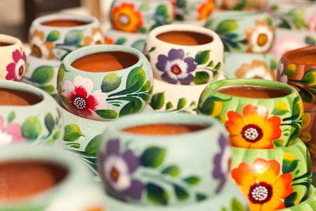 Variety of Colorfully Painted Ceramic Pots in an Outdoor Shopping Market. Stock Photo