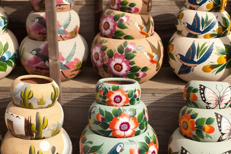 Variety of Colorfully Painted Ceramic Pots in an Outdoor Shopping Market. photo