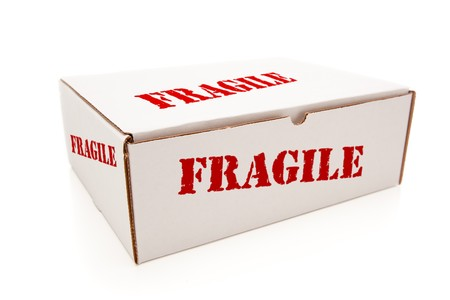 White Box with the Word Fragile on the Sides Isolated on a White Background. photo