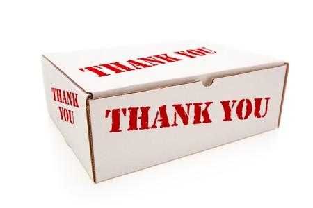 sala parto: Box bianco con le parole grazie al retro isolato su uno sfondo bianco.  Archivio Fotografico