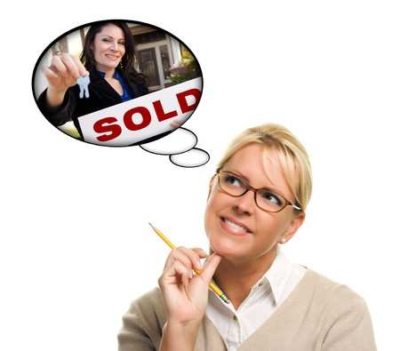 Beautiful Woman with Thought Bubbles of a Real Estate Agent Handing Over Keys to a New Home. photo