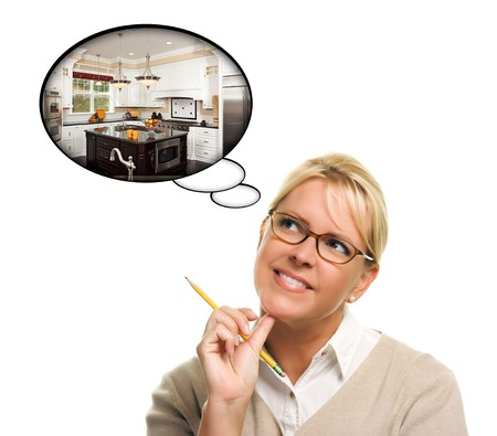 dream planning: Woman with Thought Bubbles of a New Kitchen Design Isolated on a White Background.