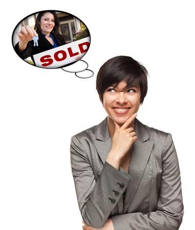 Beautiful Multiethnic Woman with Thought Bubbles of Real Estate Agent Holding Sold Sign Handing Over Keys Isolated on a White Background. photo