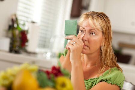 Blonde Woman Applying Her Makeup in Her Bathroom. photo