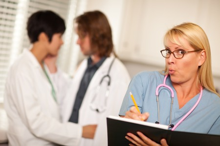 alarmed: Alarmed Medical Woman Witnesses Her Colleagues Inner Office Romance Display.