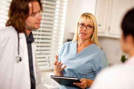 Doctors and Nurses Having A Casual Conversation in The Office. Stock Photo - 7968456