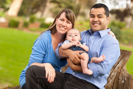 Happy Mixed Race Family Posing for A Portrait in the Park. Stock Photo - 8085197