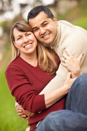 Attractive Mixed Race Couple Portrait in the Park. photo